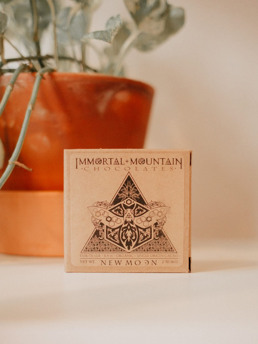 image of a kraft box of new moon cacao by immortal mountain