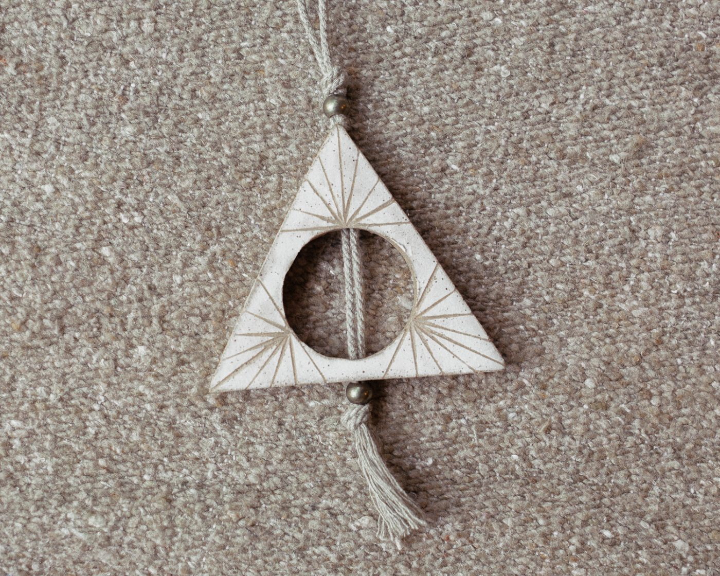 half triangle totem wall sculpture
