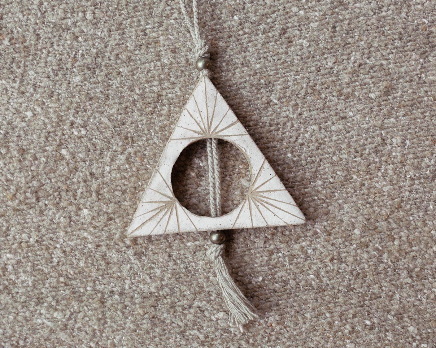 half triangle totem wall sculpture