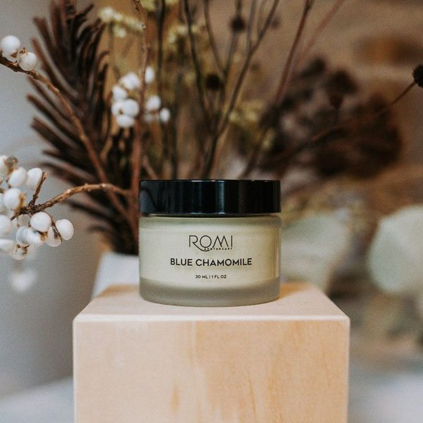 blue chamomile moisturizer by romi apothecary in front of dried florals