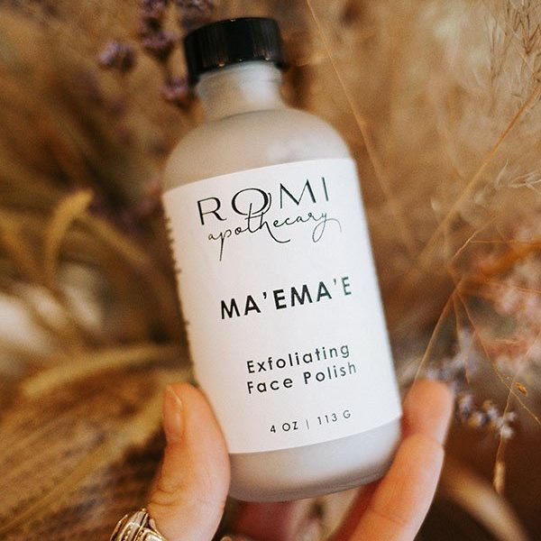 ma'ema'e face polish mask by romi apothecary in front of dried florals