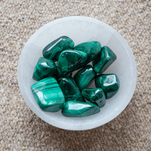 malachite stones in a crystal bowl