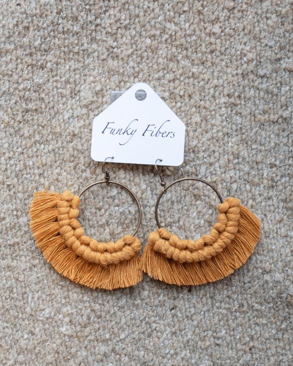 Photo of the mustard colored macrame Funky Fibers earrings
