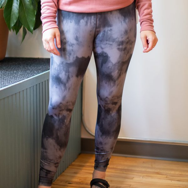 Front view of a model wearing the Beyond Yoga Grey Smoke leggings