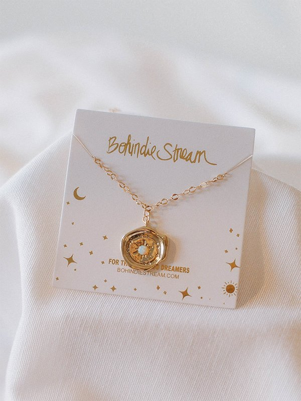 "golden-compass ""from afar"" -necklace"